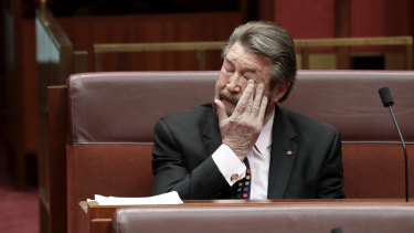 Senator Derryn Hinch takes his seat on Wednesday after speaking on Senator Fraser Anning's first speech.