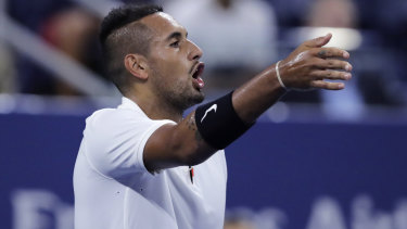 Nick Kyrgios points out distractions in the crowd during his match against Steve Johnson.