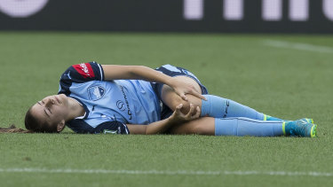 Excruciating: Amy Harrison injures her left knee playing for Sydney FC.