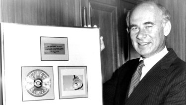 Sebel Town House general manager Michael Hall with a plaque presented to the hotel by the Dire Straits in June, 1984.
