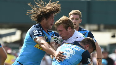 Titans' Kevin Proctor and Jai Arrow form a brick wall for Manly's Jake Trobojevic