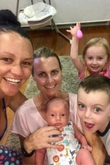 Casey Dellacqua with her partner Amanda and their three children.