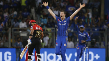 Jason Behrendorff celebrates the dismissal of Virat Kohli.