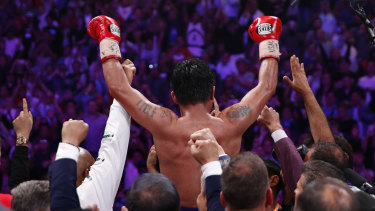Manny Pacquiao celebrates his win over Keith Thurman by split decision in a welterweight title fight.