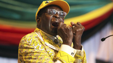 Robert Mugabe, then-President, clenches his fists as he delivers his speech at his party's annual conference in 2012.