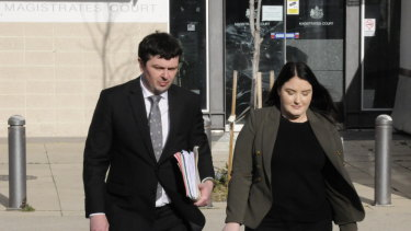 Convicted fraudster Taylor Jade Geoghegan leaves the ACT Magistrates Court with her lawyer, Michael Kukulies-Smith.