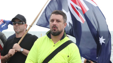 Neil Erikson, in yellow shirt, at a protest in Melbourne.