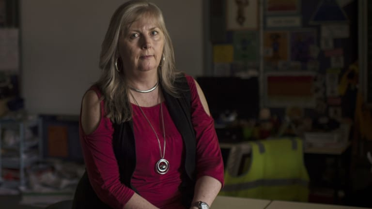 Teacher Mandy Wells uses her own money to buy supplies for her pupils.