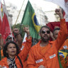Oil workers march against layoffs at the state oil company Petrobras, in Rio de Janeiro, Brazil, on Tuesday.