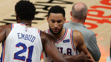 Joel Embiid has offered an olive branch to Ben Simmons (right).