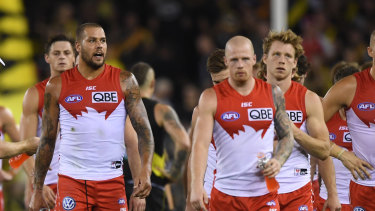 Swan dive: Sydney players come to terms with another defeat.