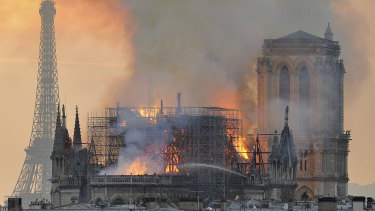 Flames and smoke rise from the burning Notre-Dame on Monday night.