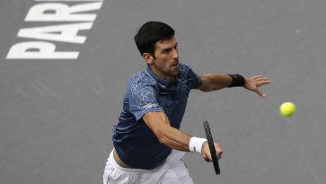 Novak Djokovic returns the ball to Karen Khachanov in Paris on Sunday.