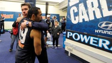 Then Carlton coach Brett Ratten embraces Betts after a match.