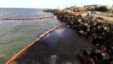 Rocks stained by an oil spill on Artistas Beach in Aracaju, Brazil.
