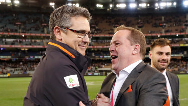Leon Cameron and chief executive Dave Matthews celebrate Greater Western Sydney's gritty win.