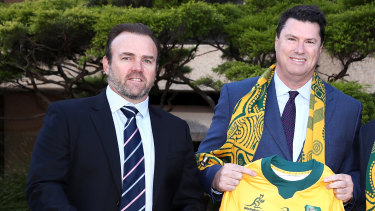 Marinos and McLennan pose for a photo at September's announcement that Australia would host the Rugby Championship.