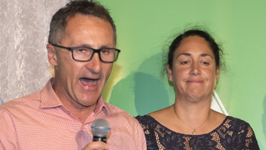 Standing with candidate Alex Bhathal, Greens leader Richard Di Natale concedes defeat in Batman.