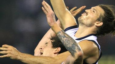The moment: Phil Davis spoils Jake Carlisle's marking attempt.