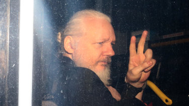 Assange in a police vehicle following his arrest at London's Ecuadorian embassy in April.