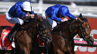 Pat Cosgrave (right) rides Benbatl to victory ahead of James Doyle riding Blair House.