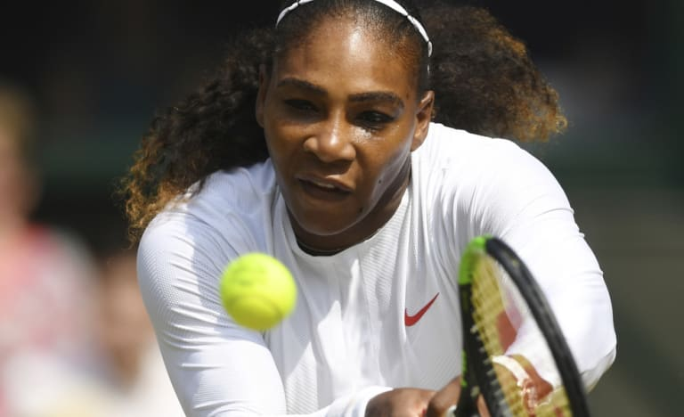 Serena Williams returns serve on her way to defeating Julia Goerges in the  women's semi-final at Wimbledon on Thursday.