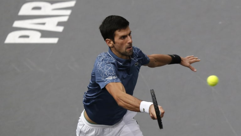 Novak Djokovic returns the ball to Karen Khachanov in Paris on Sunday.
