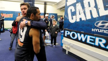 Then Carlton coach Brett Ratten embraces Betts after a match.