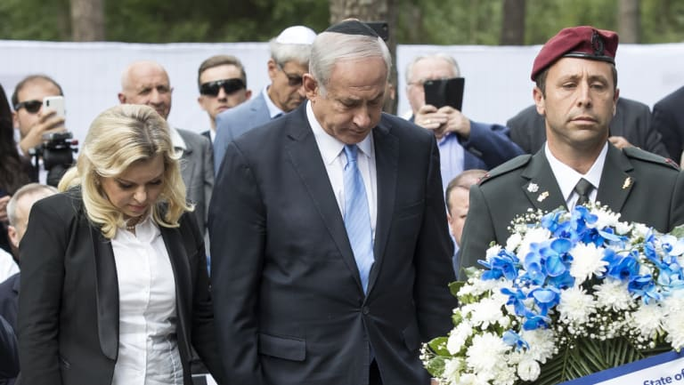 Israeli Prime Minister Benjamin Netanyahu and his wife his wife Sara Netanyahu at a commemoration ceremony of Holocaust victims at the Paneriai memorial near Vilnius, Lithuania, on Friday.