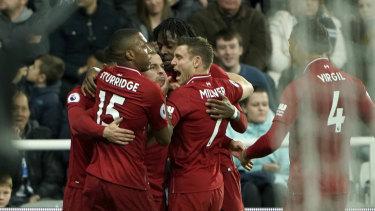 Significant: Liverpool players celebrate Divock Origi's late winner.