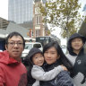 Edwin Tjandra, left, with his young family before the crash.