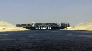 The Ever Given stuck in the Suez Canal. credit: Screengrab/BBC