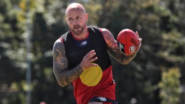 Nathan Jones makes a statement at training on Friday.