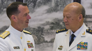 US Chief of Naval Operations Admiral John Richardson, left, and Commander of the Chinese navy Admiral Wu Shengli in 2016.