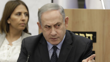 Israeli Prime Minister Benjamin Netanyahu gestures during a meeting with his nationalist allies and his Likud party members at the Knesset, Israeli Parliament, in Jerusalem.