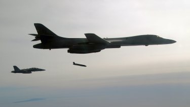 A US Air Force plane releases a Long Range Anti-Ship Missile (LRASM) during a test event. Australia is planning to buy 200 missiles to arm its air force.