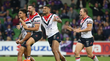 The Roosters celebrate Latrell Mitchell's (left) match-winner.