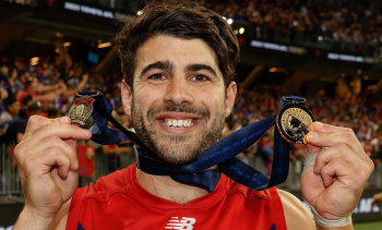 Christian Petracca with the Norm Smith and premiership medals