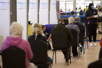 People wait for a jab at the Melbourne Showgrounds vaccination hub on Wednesday.
