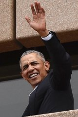 Barack Obama, waves to people at the Sydney Opera House on Friday.
