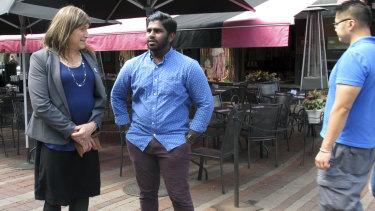 Christine Hallquist, speaks with supporter Asfar Basha in Burlington, Vermont.