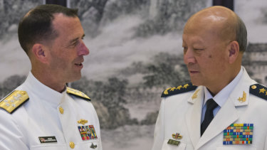 US Chief of Naval Operations Admiral John Richardson, left, and Commander of the Chinese navy, Admiral Wu Shengli in 2016.