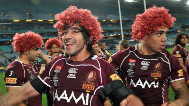The Queenslanders celebrate a comprehensive series win.