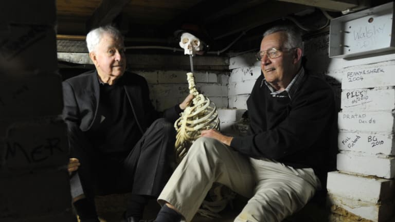 Ross Thomas, left, and Peter Anderson share a yarn with a skeleton in the 'room within a room'.