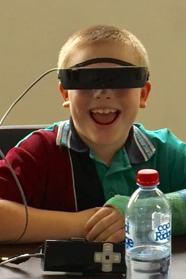 Max Geoghegan, the first Queenslander to receive a pair of eSight glasses.