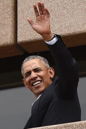 Barack Obama, waves to people at the Sydney Opera House on Friday.