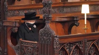 The Queen takes her seat ahead of the funeral.