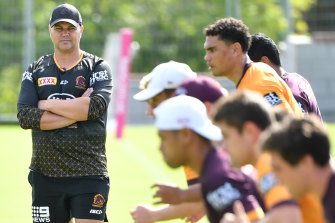 Broncos coach Anthony Seibold puts the players through their paces at training.
