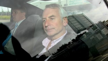 Paul Peters arrives in Australia with a police escort in September 2011.