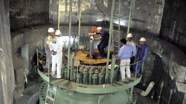 Technicians work in the reactor of Iran's Bushehr nuclear power plant in a 2004 picture, released by Iran's Atomic Energy Organisation.